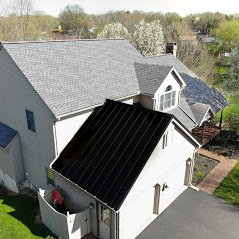 grey shingles with black metal roof