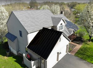 grey shingled roof with metal garage roof med