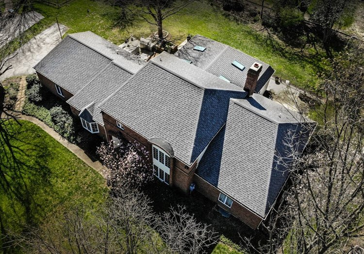 grey shingled roof aerial view mansion2